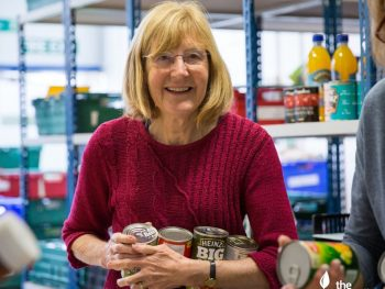 A lady donating to a foodbank