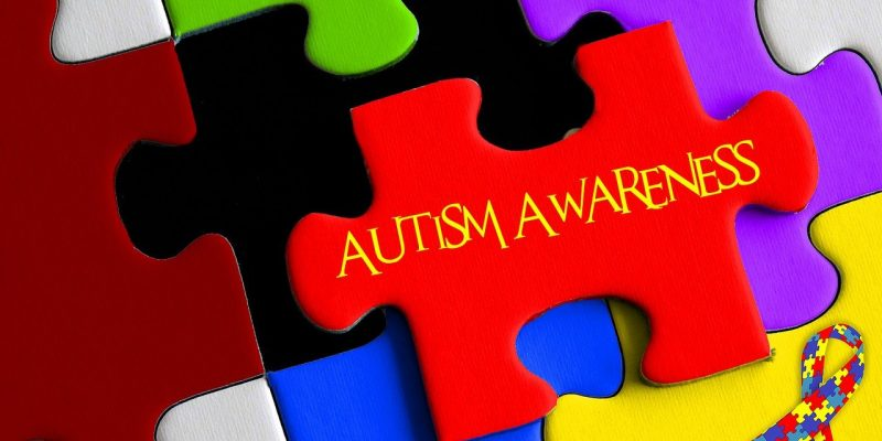 Jigsaw image with a piece out of place with 'autism awareness' on it.