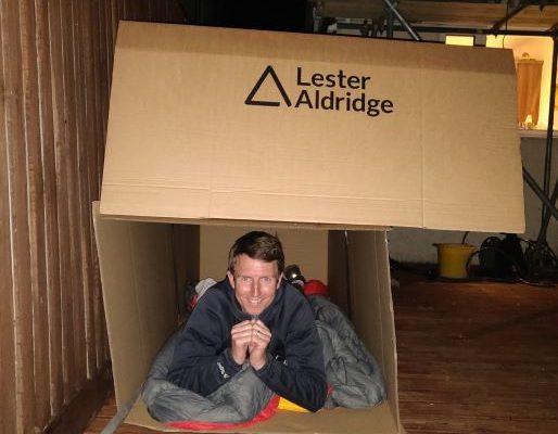 Teacher in cardboard box