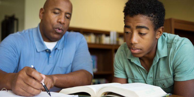boy being tutored by man