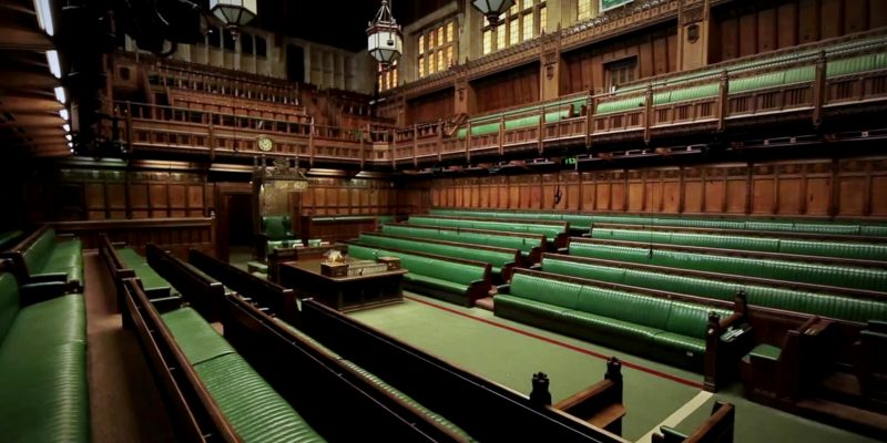 a picture of an empty house of commons