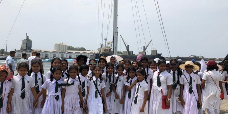 A group of children dressed in white