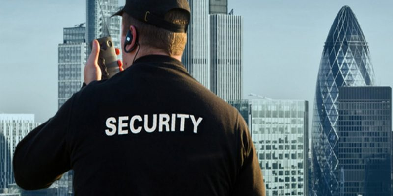 A security guard overlooking the London skyline