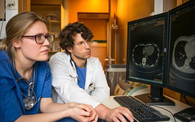 Nurses examining scans