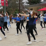 Cheerleading group promote new film 'Blue as the Sky'